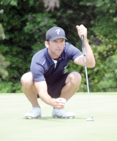 NCIS-New Orleans star Lucas Black lines up a putt at Green Valley.