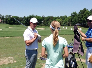 Grace Vaughan and Rory Mcllroy on the practice tee.