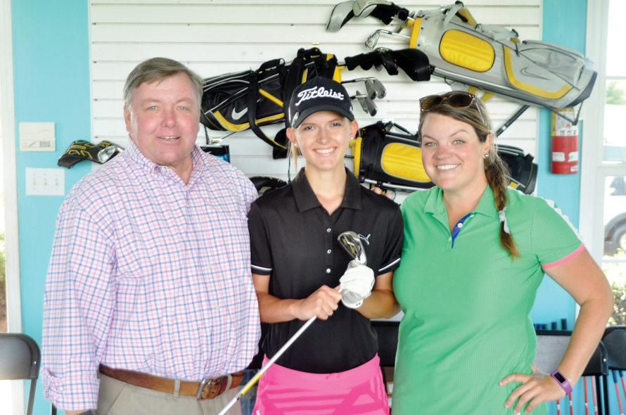 Grace Vaughan and the First Tee Staff at Woodfin Ridge. John Combs PGA Professional and Audrey Church, Program Director