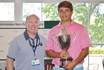 Andrew Novak receives his championship trophy from Andy Pries of the CGA (Photo from CGA)