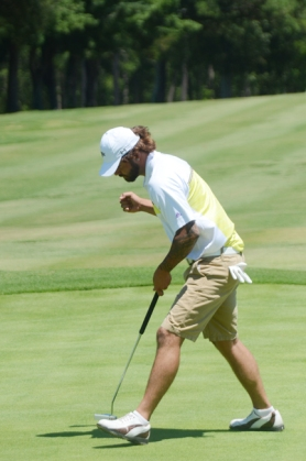 Derrick Oyervides celebrates his birdie putt on the 18th hole at Greer to send the GGO to a playoff.