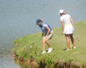 Woodard's second shot on number 16 found the water and turned the lead back to Cox.