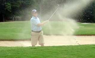 A difficult bunker shot cost Johnson the lead at the Greenville County Am.