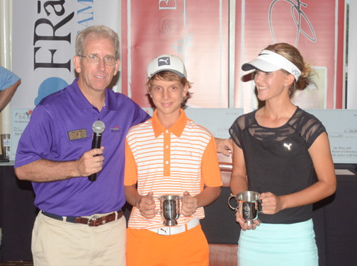 Tournament Director Rob Reeves presents Jack and Grace Vaughan with the Spirit Award at The Blade Junior Golf Classic