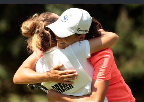 Justine Dreher hugs her caddie after defeating the top seed in the US Women's Am.