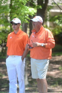 Head coach Larry Penley (r) and assistant coach Jordan Byrd (l) look on as the Tigers won the ACC Tournament at 25-under par.
