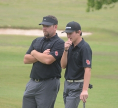 Boiling Springs coach Josh Pruitt discuss a shot with Trent Phillips.