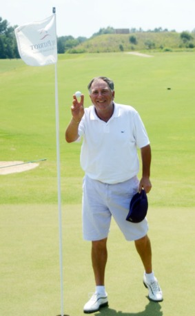 Liebler shows off the ball he used to win the Festival of Flowers with an eagle 2 on the playoff hole.