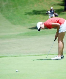 PC golfer Abby Driscoll tries to will her final putt into the hole. She finished in a tie for second place.