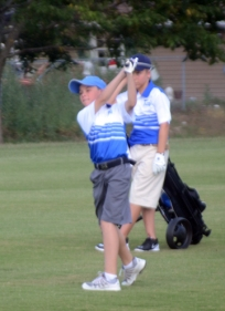 Ethan Moore of the Carolina Springs PGA Junior Team hits an approach shot during a match.