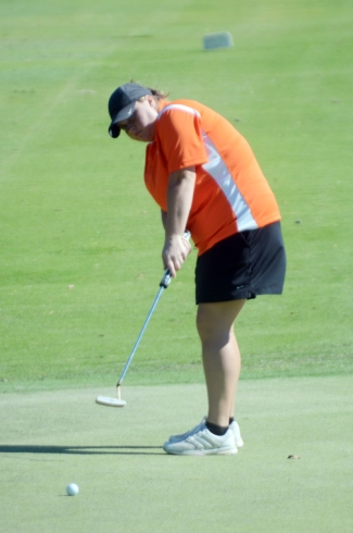 Emily Cox won the AAA championship with an eagle putt on the first playoff hole.