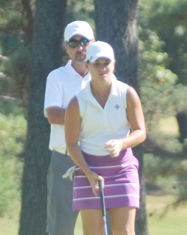 Lady Paladin coach Jeff Rule helps Haylee Harford line up a putt at The Lady Paladin Invitational.